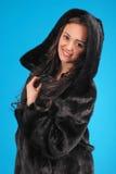 Beautiful young girl in fur coat Stock Photos