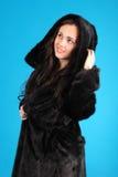 Beautiful young girl in fur coat Royalty Free Stock Photos