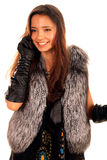Beautiful young girl in fur coat talking by phone royalty free stock photo