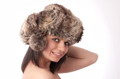 Beautiful young girl with fur hat Royalty Free Stock Photography