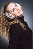 Beautiful young girl in fur headphones Royalty Free Stock Images