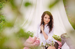 Beautiful young girl in garden Royalty Free Stock Image