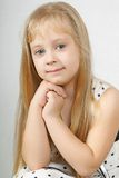 Beautiful young girl gazing intently at you Royalty Free Stock Image