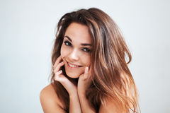 The beautiful young girl gently smiles royalty free stock photo