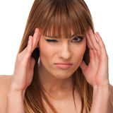 Beautiful young girl gesturing headache Stock Photo