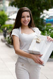 The beautiful young girl with a gift Royalty Free Stock Image