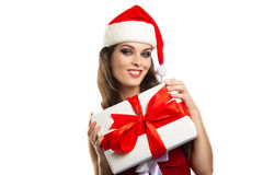 Beautiful young girl with a gift in Christmas costumes Royalty Free Stock Photos