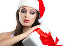 Beautiful young girl with a gift in Christmas costumes Royalty Free Stock Image
