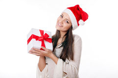 Beautiful young girl  with gift in hand on a white background Royalty Free Stock Photography