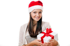 Beautiful young girl  with gift in hand on a white background Stock Photography