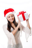 Beautiful young girl  with gift in hand on a white background Royalty Free Stock Images