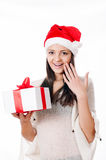 Beautiful young girl  with gift in hand on a white background Stock Photos