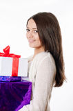 Beautiful young girl  with gifts in hand on a white background Stock Photo