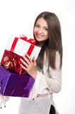 Beautiful young girl  with gifts in hand on a white background Stock Image