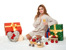 Beautiful young girl with a glass of champagne and gift boxes Stock Images