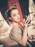Beautiful young girl with glass of red wine Royalty Free Stock Images