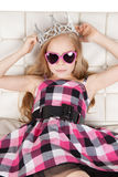 Beautiful young girl with glasses and crown Stock Photo