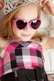Beautiful young girl with glasses and crown Royalty Free Stock Image