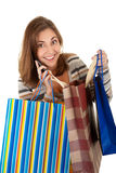 Beautiful young girl goes shopping with a phone in Stock Photo