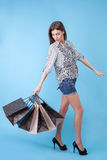 Beautiful young girl is going shopping with joy Stock Photo