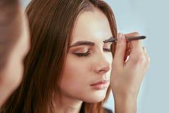 Beautiful young girl got correction of eyebrows in a beauty salon Stock Photos