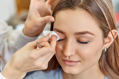 Beautiful young girl got correction of eyebrows in a beauty salon Royalty Free Stock Photos