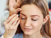 Beautiful young girl got correction of eyebrows in a beauty salon Stock Photography