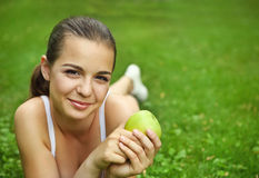 Beautiful young girl with green apple Royalty Free Stock Photography