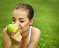Beautiful young girl with green apple Stock Photo
