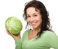 Beautiful young girl with green cabbage Royalty Free Stock Image