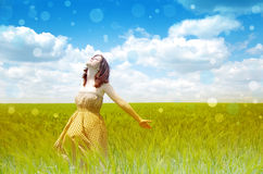 Beautiful young girl at green field Stock Images