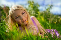 Beautiful young girl on green grass in the summer Royalty Free Stock Photography