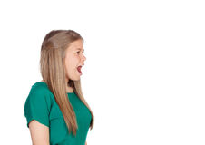 Beautiful young girl with green t-shirt screaming out loud. Isolated on white background Royalty Free Stock Image