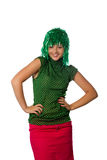 Beautiful young girl with green wig on white Stock Image