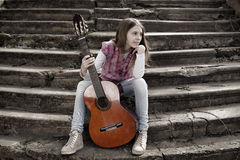 Beautiful Young Girl With Guitar Against Old Stone Staircase Royalty Free Stock Image