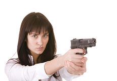 Beautiful young girl with gun. royalty free stock photography