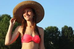 Beautiful young girl in hat closeup on the beach Royalty Free Stock Photo