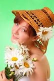 Beautiful young girl in the hat with flowers Royalty Free Stock Images