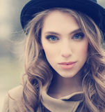 Beautiful young girl in hat outdoors Stock Photography