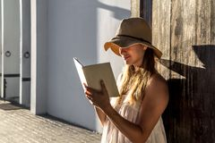 Girl reading a book at dawn stock images
