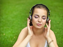 Beautiful young girl with headphones Royalty Free Stock Photos