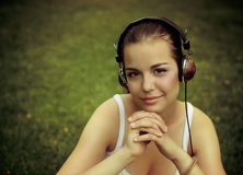 Beautiful young girl with headphones Royalty Free Stock Image