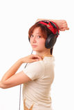 Beautiful young girl with headphones Stock Photos