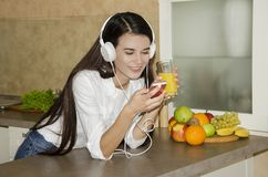 Beautiful young girl with headphones Royalty Free Stock Photography