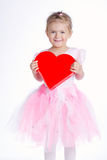 Beautiful young girl with heart Stock Image