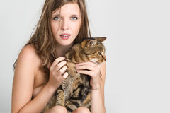 A beautiful young girl with her cat Royalty Free Stock Images