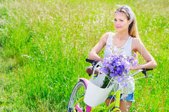 Beautiful young girl with her cruiser bike Royalty Free Stock Photography