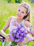 Beautiful young girl with her cruiser bike Royalty Free Stock Image