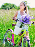 Beautiful young girl with her cruiser bike Stock Image