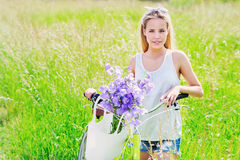Beautiful young girl with her cruiser bike Royalty Free Stock Photos